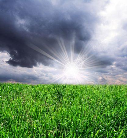 grassland and storm cloud photo