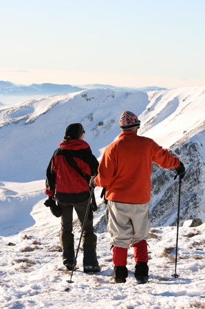 Hikers in winter mountains photo