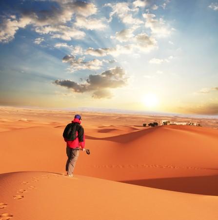 man go  in sand desert photo