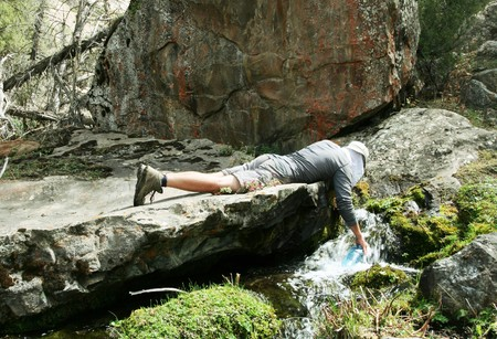 man drinking water: People in hike Stock Photo