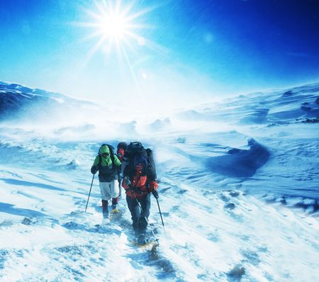 Hike in winter mountain photo