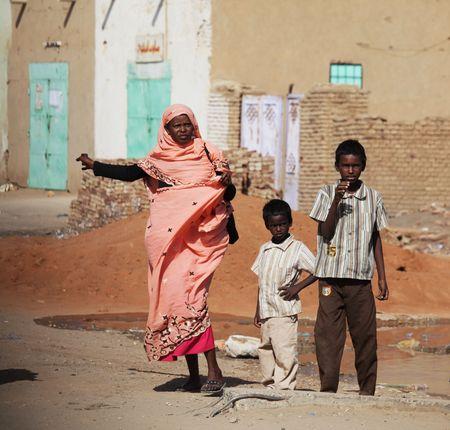 SUDAN - JANUARY 09, 2010: Sudanese people walking from a bazaar in rural area near Khartoum on January 29, 2010.