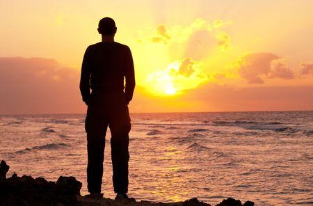 morning sunrise: man silhouette on the sunset