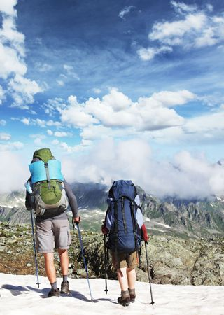 Hiker in mountains Stock Photo - 6529236