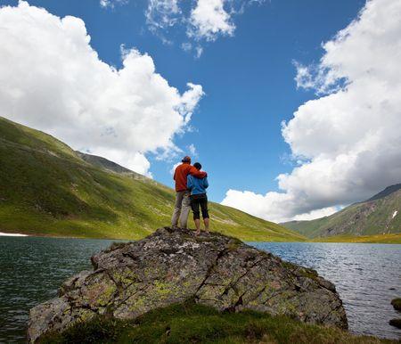hike: Couple on mountains lake
