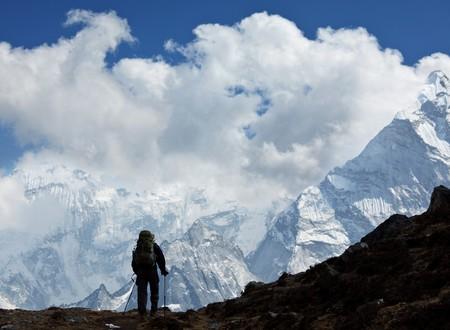 Hiker in Himalayan mountains photo