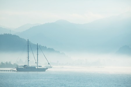 yacht in morning bay photo