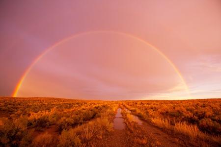 Rainbow in mountains Stock Photo - 8237216