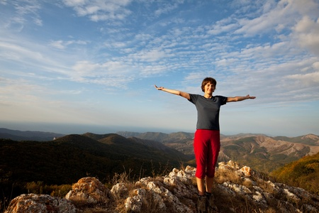 exultation: Happy girl in mountains Stock Photo
