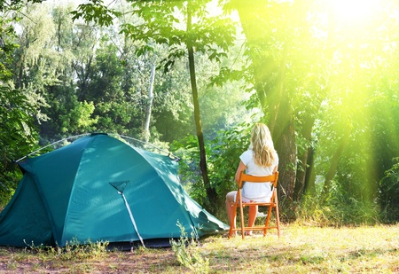 Girl resting in camping photo