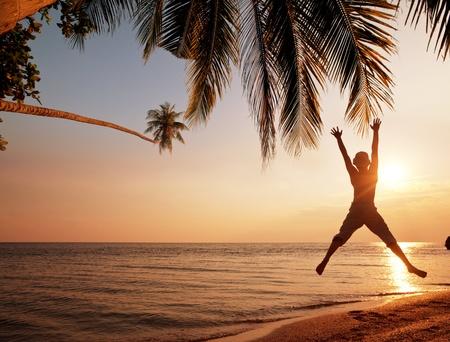 freedom: boy on the beach Stock Photo