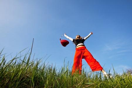 exult: Happy girl on grassland Stock Photo