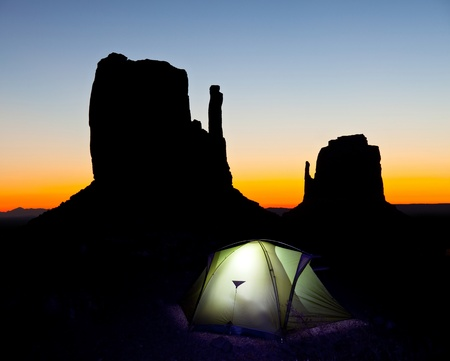 settled: Tent in Monument Valley at night