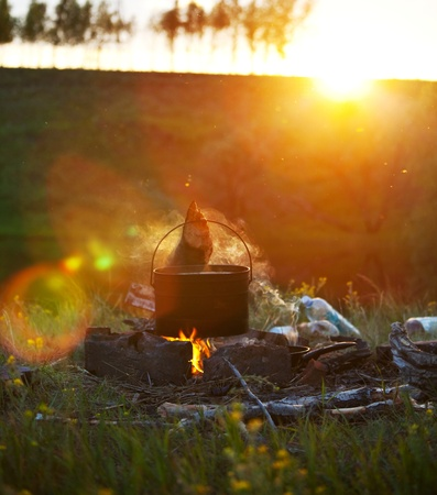 campfires: Old kettle in camping Stock Photo
