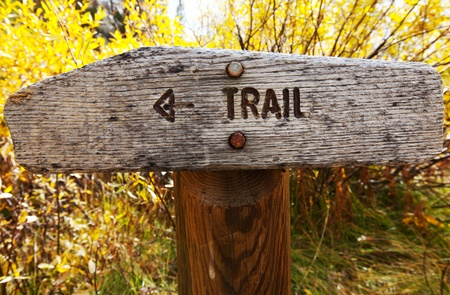Sign points to a hiking trail photo