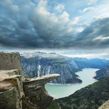 woman mountain: Trolltunga in Norway