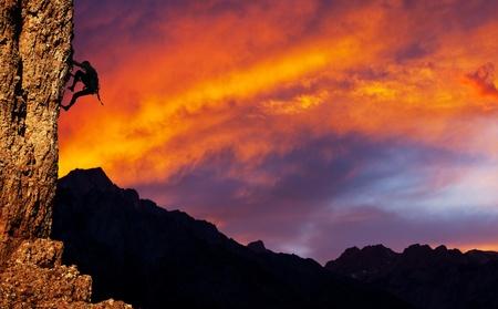 climber on sunset background photo