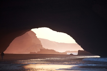 eroded: Arch rock formation on the beach, Morocco