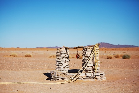 water well: alone  well in Sahara desert,Morocco Stock Photo