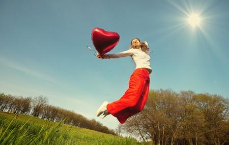 exultation: Happy girl on grassland Stock Photo
