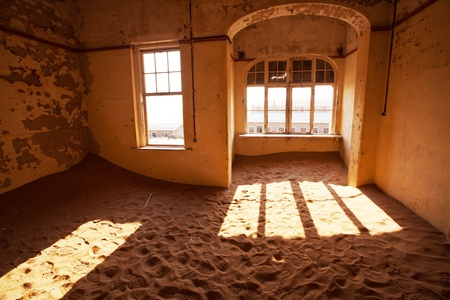 luderitz: Ruins of abandoned houses in the ghost diamond town Kolmanskop, Namibia, Africa in storm