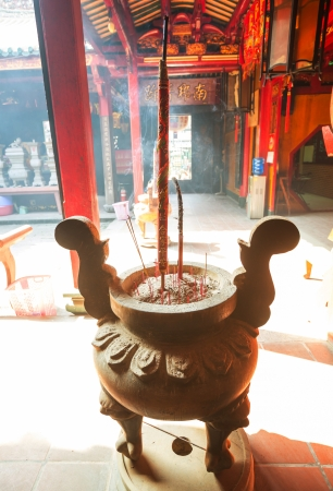 Buddhist prayer sticks in chinese temple photo