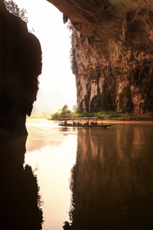 river in cave, BaBe lake NP, Vietnam photo