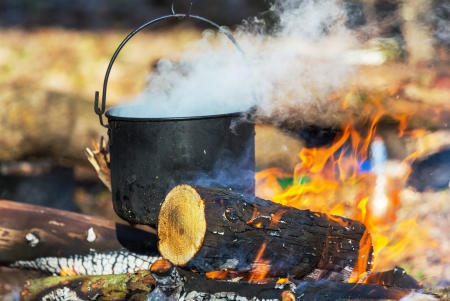 cooking ware: Old kettle in camping Stock Photo
