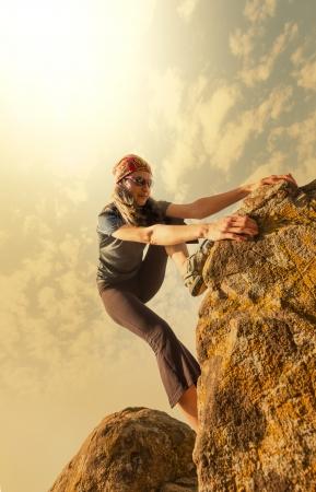 Climber climb the rock photo