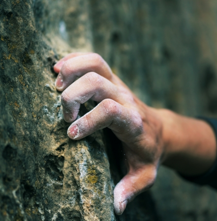 grasp: Rock climbers hand Stock Photo