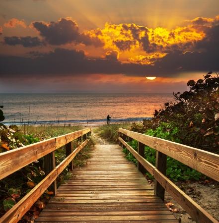 sunrise beach: boardwalk on beach