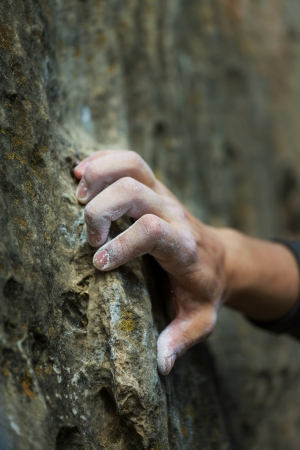 hang body: Rock climbers hand Stock Photo
