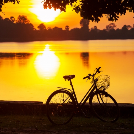 Bicycle in sunset photo