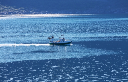 romantically: Fishing boat in Norway Stock Photo