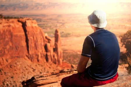 colorado mountains: man on the cliff
