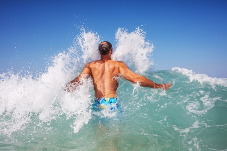 man in wave photo