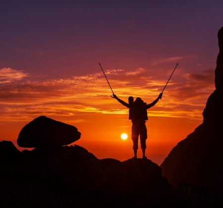 hiker at sunset photo