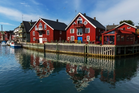 Red wooden fishing cabins in   Norway photo