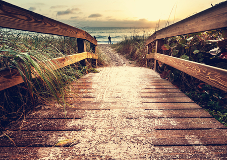 romantic background: boardwalk on beach