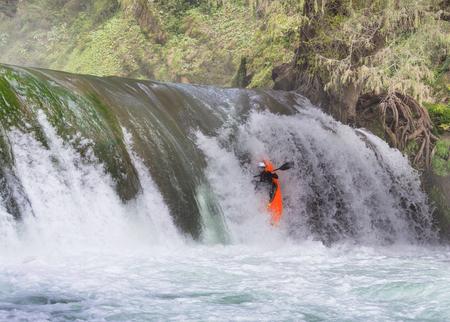 kayaker: Kayaker in waterfall