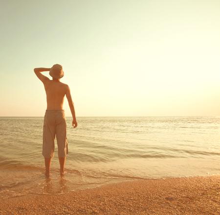 boy on the beach photo