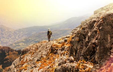 mountain climbing:  hiking in  mountains Stock Photo