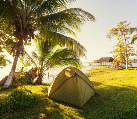 tent on green grassland photo