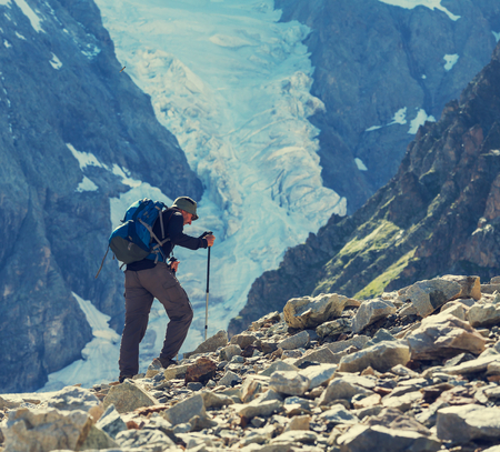 Backpacker in mountains Stock Photo - 30523705