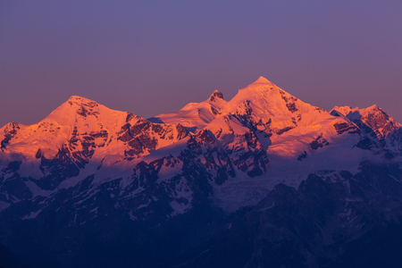 shkhara: main Caucasian ridge at sunset Tetnuld and Gestola peaks,Georgia Stock Photo