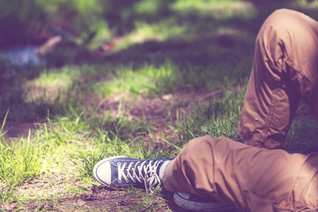 rest and relaxation: Relaxing boy in a meadow Stock Photo