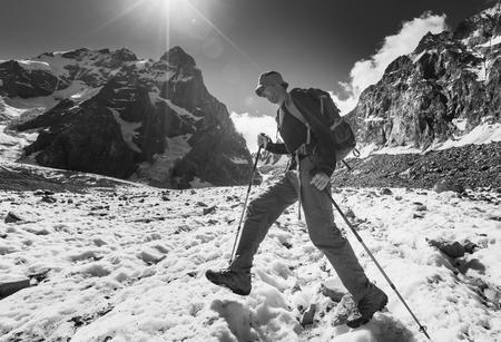 backpacker: Backpacker in snowy mountain Stock Photo
