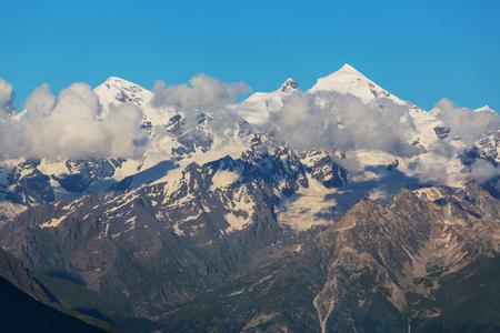 shkhara: main Caucasian ridge at sunset.Tetnuld and Gestola peaksGeorgia Stock Photo