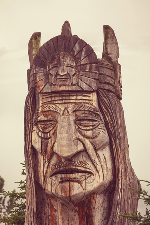 the totem pole: statue of an indian head totem