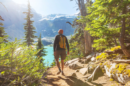 hiking: Hiking man in the mountains Stock Photo